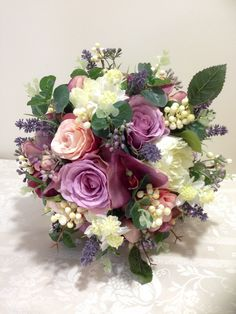 Vintage bouquet in everlasting flowers. Roses, phaleanopsis orchids, lavender, berries.