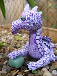 Shesha the Purple Dragon who walks alone and stands apart from all the others. Her name means 'that which remains' as there are few purple dragons still in existence. Made by Lorraine @ Soulsecrets and inspired by Birdy Heywood