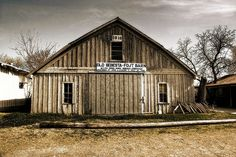 """Built in 1916, this barn located in Snook, Texas offered """"Milch Cows-Work Horses-Corn And Hay"""" for sale. The barn was restored in 1986 by John J. and Frank J. Fojt, Jr."""