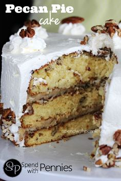 Pecan Pie Cake!  3 Layers of delicious pecan crusted cake with an amazing homemade filling and frosting with fresh whipped cream!