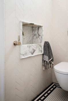 Art Deco Apartment, Potts Point Recessed arabescato marble hand basin and polished nickel tapware to powder room.