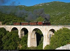RailPictures.Net Photo: Milee Hellenic railways Tubize at Volos, Greece by Billchor. This is the Belgina Tubize 2-4-0 steam loco crossing the Malaki stone bridge.