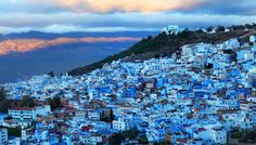 Located in the dramatic Rif mountains in the north of Morocco, Chefchaouen is known for its striking blue houses nestled against the rough green and brown of the mountain scenery. The old quarter of the town is heavily influenced by Islamic and Andalusian architecture, from the blue-painted walls and red-tiled roofs, to iconic keyhole-shaped doorways and tiled passages winding through the city.