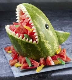 One of my favorite shows, Raising Hope, had a watermelon shark on tonight's episode. I love the added candy fish for effect....  BDay party ideas