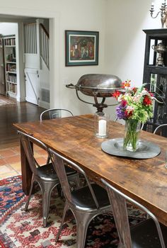 Wooden dining table and metal bucket chairs.
