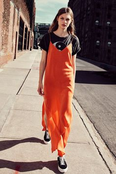 For a bright spring look, pair a graphic tee with an orange silk slip dress and sneakers. Let Daily Dress Me help you find the perfect outfit for whatever the weather! dailydressme.com/