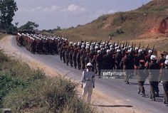 Soldiers of the French Foreign Legion parade through Bao Ninh, in the former Indochina.