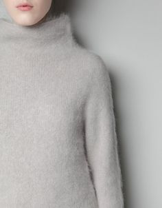 Angora sweater. Love the funnel neck. Would pair this piece with pin-striped charcoal grey wide-leg trousers. Add a wide bangle and you're good to go. :)
