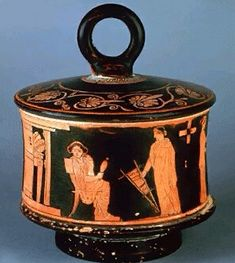 Red Figure Pyxis -   Red figure painting on Greek pottery dates back to the 6th century BC.  The pyxis is decorated with domestic scenes. This example shows two women. One is spinning and the other is holding a hand loom. This pyxis dates to 430 BC.