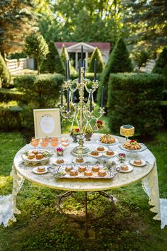 A same-sex wedding inspiration shoot in a beautiful, formal English tea garden in Minneapolis | Carina Photographics: http://carinaphotographics.com