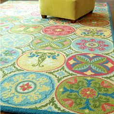 love these rug colors and design