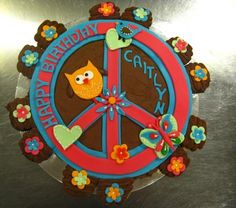 Cupcake cake with peace sign and owls