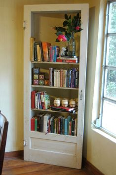 Old door becomes bookshelf. I may have to try this for one of the old screen doors I picked up from my Mom's garage attic Old Screen Doors, Old Doors, Repurposed Furniture, Diy Furniture, Repurposed Doors, Salvaged Doors, Corner Shelves, Home Projects, Bookshelves