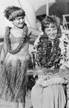 News Photo : Amelia Earhart Putnam is shown draped with leis,. Cheap International Flights, Female Pilot, Great Women, Amazing Women, Women In History, Ancient History, One Pilots, Historical Photos, Hawaii