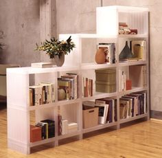 Good idea for a room divider that includes storage!