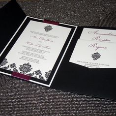 Classic black and white damask images are accented with satin ribbon and rhinestones for a gorgeous, unique invitation that is sure to impress