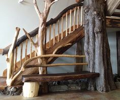 Unique custom built log bench, and stairway | Built by Artisan Log Homes #LogHome