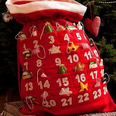 Santa Sack Advent Calendar with tree ornaments idea-- source unknown