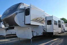 The Montana Mountaineer 345DBQ is a quad bunk fifth wheel for the larger family needing extra beds and preferring a separate room for the kids. The quad-slide has a rear bunkhouse with dual bunks, wardrobe and the beauty of a half bath. The Mountaineer 345DBQ doesn't scrimp in space either. The living/kitchen area and master bedroom have all the comforts and space for residential living!
