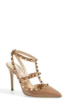 "Free shipping and returns on Valentino 'Rockstud' T-Strap Pump (Women) at Nordstrom.com. <p><B STYLE=""COLOR:#990000"">Pre-order this style today! Add to Shopping Bag to view approximate ship date. You'll be charged only when your item ships.</b></p><br>Pyramid studs boldly decorate a pointy-toe pump shaped from lavishly textured leather."