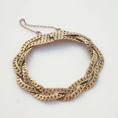 Hey, I found this really awesome Etsy listing at http://www.etsy.com/listing/128044645/vintage-gold-braided-link-bracelet-1940s