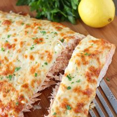 Cheesy, Onion Crusted Baked Salmon Recipe Main Dishes with salmon fillets, onions, ground black pepper, salt, mayonnaise, lemon juice, dijon mustard, garlic cloves, parmesan cheese, mozzarella cheese