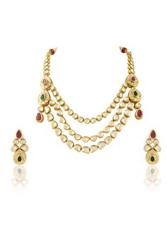 Vilandi set with ruby and emerald green stone in gold plating. Item number J15-207