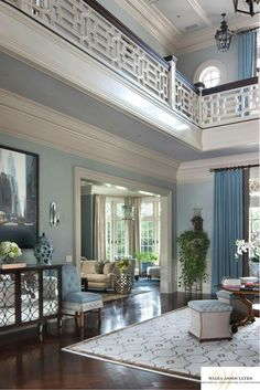 Droll-worthy two story entry/living room/library? What an amazing Chippendale railing.
