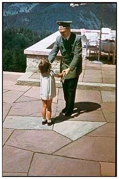 Adolf Hitler playing with one of Goebbels' daughters at the Berghof in Berchtesgaden, Germany
