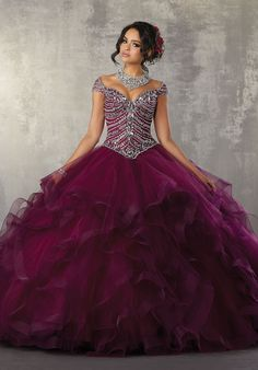 Tulle Quinceañera Dress Featuring a Gorgeous Beaded Bodice and Off the Shoulder Neckline. A Full Flounced Skirt Trimmed in Horsehair Complete the Look.