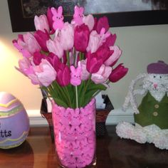 Cute Easter arrangement using peeps and tulips.
