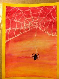 Spin met web gemaakt van sterke lijm, goed laten drogen, dan ecoline erover. Mooi effect geeft het ook als je het blad éérst nat maakt voordat je er ecoline over heen doet( herfst kleuren)