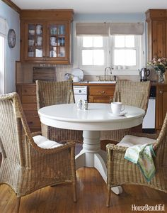 This combination of wicker and white creates the dreamiest spot to relax over a cup of tea as the morning fog rolls in.   - HouseBeautiful.com
