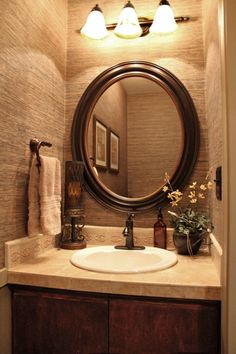 bathrooms - Delta, Faucet,  grasscloth add a wonderful texture to this tiny bathroom