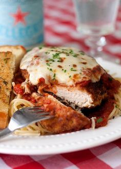 Chicken Parmesan    1 cup all-purpose flour  2 eggs  3 cups fresh breadcrumbs*  4 boneless, skinless chicken breasts  salt and pepper  1/2 cup vegetable oil  2 cups marinara sauce  1 cup mozzarella cheese, shredded  1/4 cup Parmesan cheese, shredded