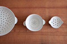 """Ando Masanobu's first solo show in North America: """"Kita Wou Omou Utsuwa"""". From left: a large colander, medium colander, and a soap dish."""
