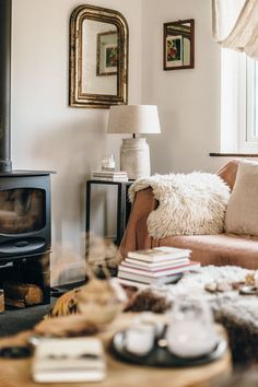 my scandinavian home: 12 Budget Friendly Ways To Transform Your Living Room Into a Cosy Winter Haven! Hygge, Malm, Living Room Sets, Living Spaces, Sheepskin Throw, Cosy Winter, Cosy Corner, Kitchens And Bedrooms, Bedroom Ceiling