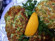 Zucchini & tofu Fritters, used garbanzo bean flour, quinoa for the crumbs, & no cheese! Awesome!