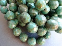Premium Czech Beads - 10mm Turquoise Picasso - Faceted Rounds. $3.15, via Etsy.