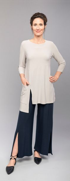 The Sympli Chop Tunic has a great funky style that any artist at heart will love. Features: 3/4 sleeves, over sized pocket at right side hem, side slit at left side hem, grew neckline, choppy block cut out hem line.  Sympli Chop Tunic 3/4 Sleeve, 2396-3   Available in Black, White, Navy, and Oatmeal. Available Thru Size 26