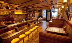 Worth the wait: Hoppers, 49 Frith Street, Soho, a pleasant interior with stools at a bar and banquettes