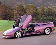 Decorate your room's wall with this Lamborghini Diablo Open Door view automobile car art print poster. It would sure to add a nice ambience into your home. This poster is a perfect for any teen age boy bed room. Grab this charming poster for its high quality gloss finish paper with archival quality inks which ensures long lasting beauty and color fading.