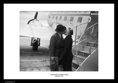 "A farewell kiss at Dublin Airport.29th May 1952   16"" x 12"" black and white print Price includes 13.5% VAT. All Lensmen Photographic Archive Original Fine Art Prints are printed on Archive Photographic rag paper, using the latest printing technology, with a certificate of authenticity and embossed stamp.   FREE SHIPPING for limited time offer.   If your order arrives damaged or is not correct, please get in touch immediately and I will rectify the matter. You ..."