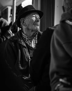 #streetphotography #streetphoto #blackandwhite #loneliness #old #person #lisbon #lisboa #trem #hat #spotlight #beamoflight #mysterious by cristianophoto