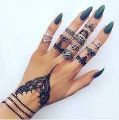 Nails. Check. Rings. Check. Henna. Check. We it all! Get your #henna #tattoos @indigo_lune #rings #nails #cross #ohm #eye #prayyourway