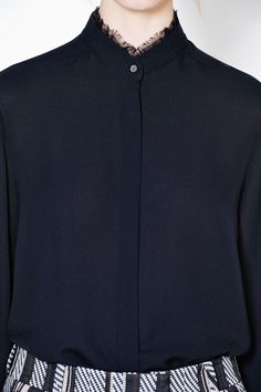 DESIGNER CLOTHING   3.1 PHILLIP LIM Perfect for work. Elegant designer shirt in black. Classic silk Henley shirt updated with a subtly frayed ruffle tucked under the collar for a sophisticated, but not studied, effect. 100% Silk Dry Clean only