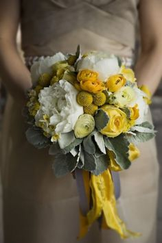 yellow roses, white peonies, yellow billy balls and lambs ear bouquet compliment a gray bridesmaid dress