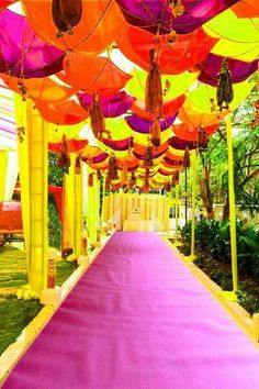 Bright and colourful umbrellas for an outdoor summer wedding