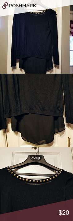 ⬇️PRICE DROP⬇️ Express Top Amazing sweater with sheer black underneath, it, neck line is framed by studs on the front as well as the back, top also has a split back that is attached at the top and open at the bottom, body is made of 67% viscose and 33% silk and the lining is 100% polyester, size M Express Sweaters