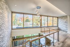 Ferndale Residence featuring ErthCOVERINGS Silver Fox Panels (SF-PAN) on the interior walls of the stairway